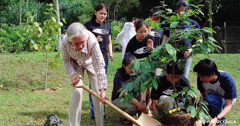 Dr. Goodall and Roots & Shoots Members Plant Trees.