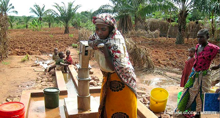 Amena Hassan, a farmer and housewife in Kasuku Village, Kigoma Region, saves as much as eight hours in a day fetching water now that TACARE has installed a sanitary water system. 2006