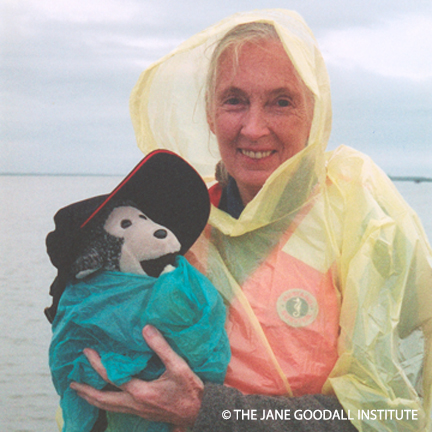 Dr. Jane Goodall and her mascot Mr. H weather the storm on a boat off of the coast of Port Aransas, Texas. 2003.