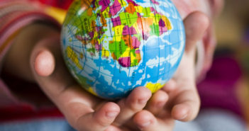 hands-holding-small-globe-of-earth