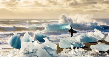 Looking for an opening between the ice, Dion Agius prepares to paddle out amidst the raw Icelandic coast, 2012. Credit: Chris Burkard/Massif