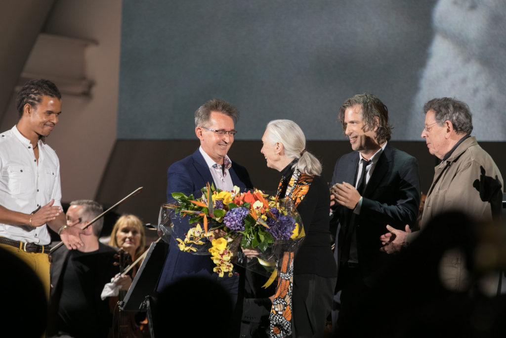 Dr. Jane Goodall is presented flowers by her son Grub van Lawick following the National Geographic screening of the feature documentary JANE. Jane will be in select theaters October 20. (National Geographic/Rebecca Hale)