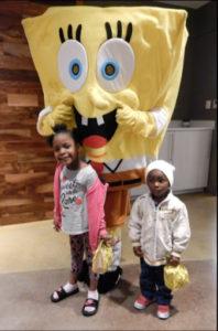 Stewart (dressed as Spongebob Squarepants) with community members