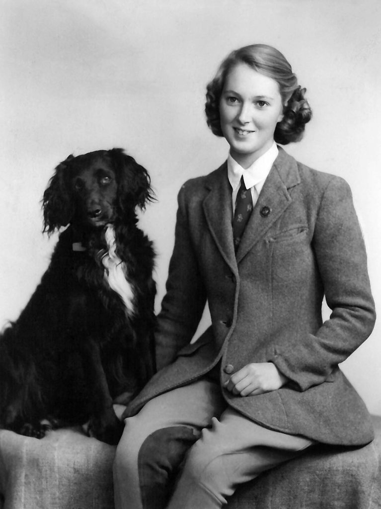 """Jane with Rusty. Taken in Bournemouth 1954. Written on the back: """"Jane and Rusty the Inseperables"""""""